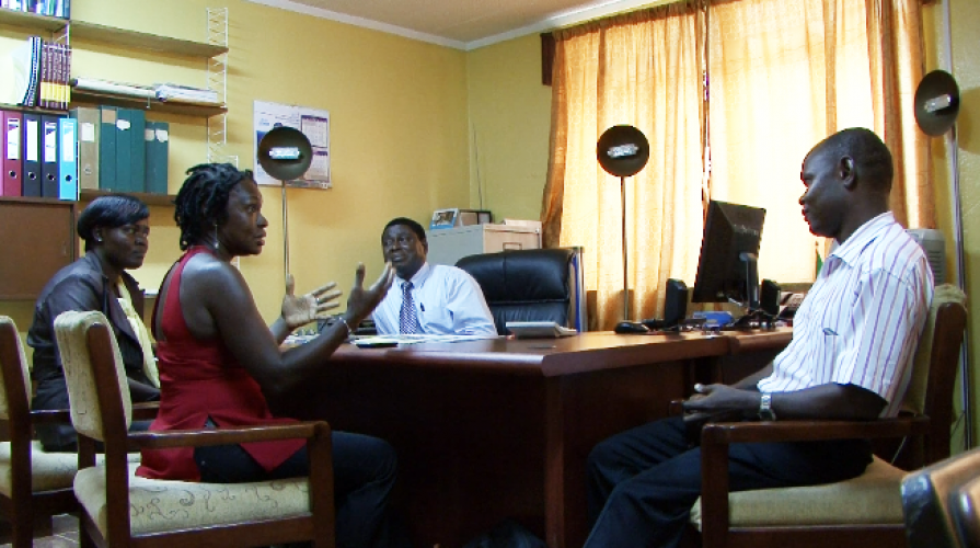 a meeting with Chief Librarian and staff of the central library in Freetown