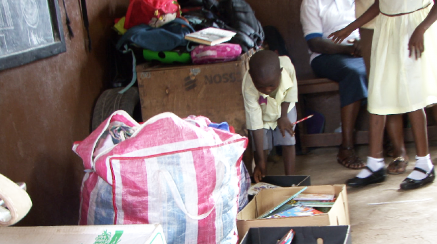 books and clothes donated to primary school pupils