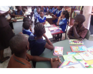 children at the Freetown Central library receiving some donated books