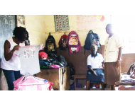 distributing clothes and books to primary school pupils